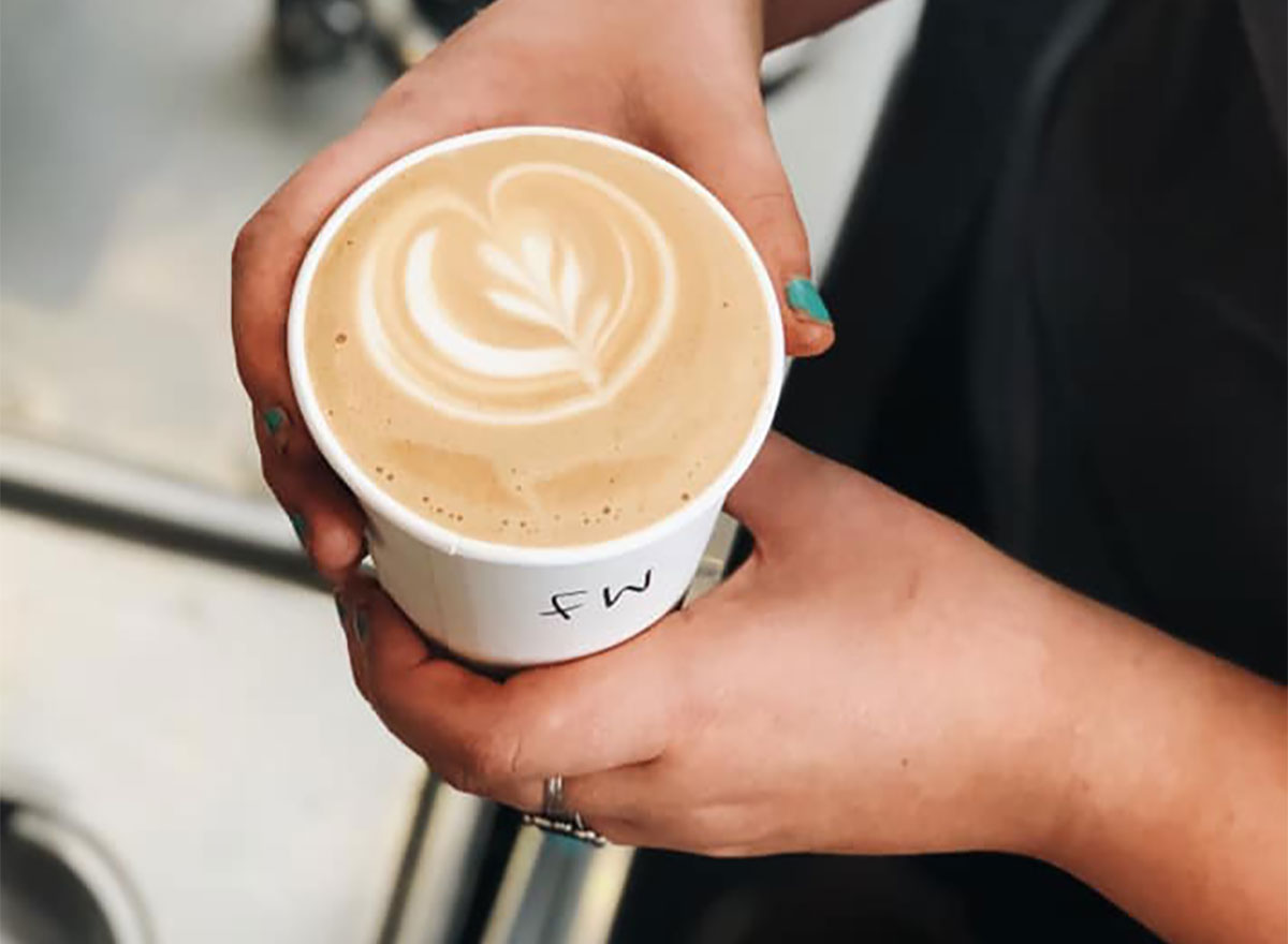 latte closeup in woman's hands