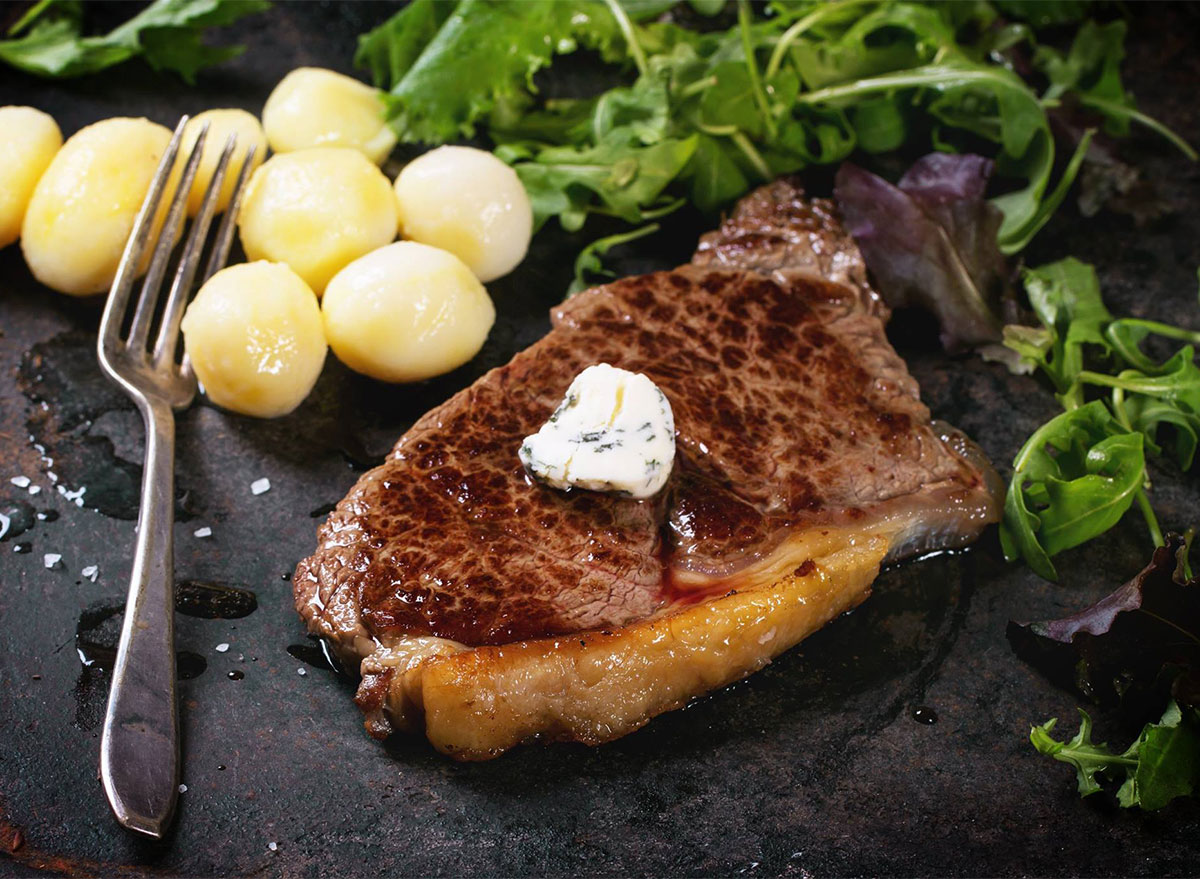 steak with butter and mini potatoes