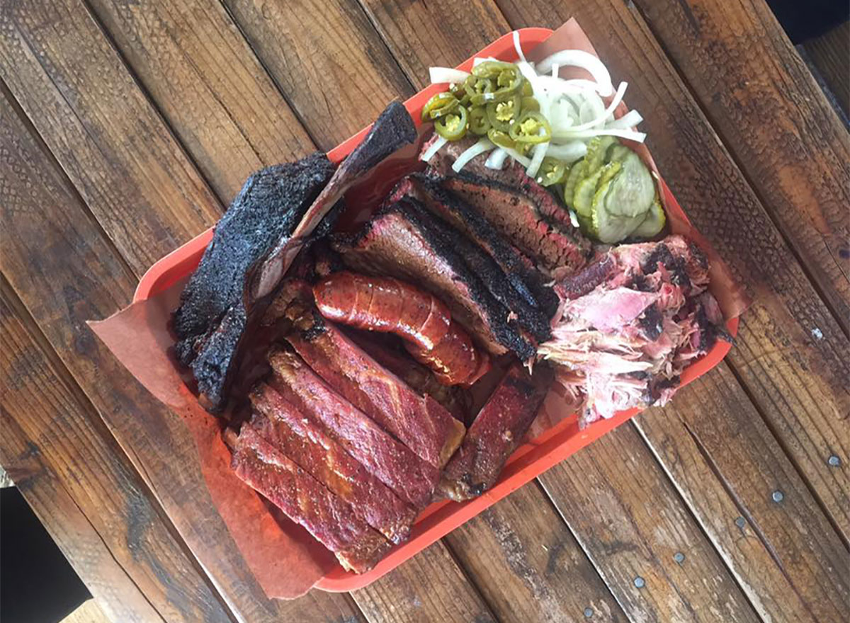 plate of barbecue with pickled veggies