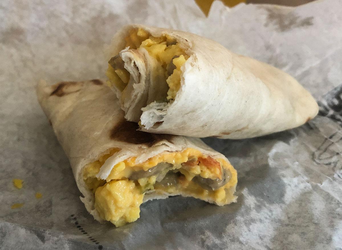 two mcdonalds sausage burritos with bites