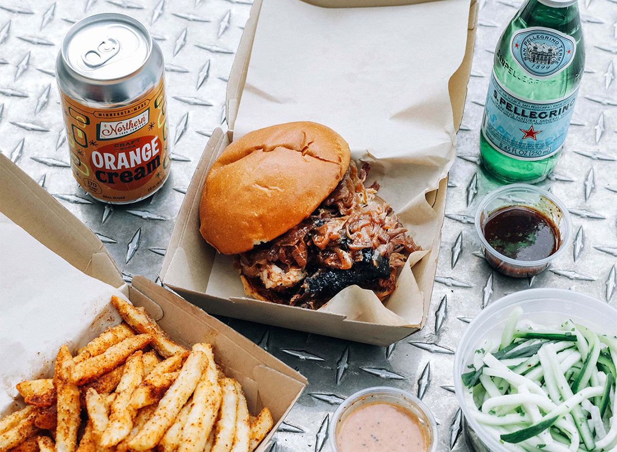 barbecue sandwich with beer and fries