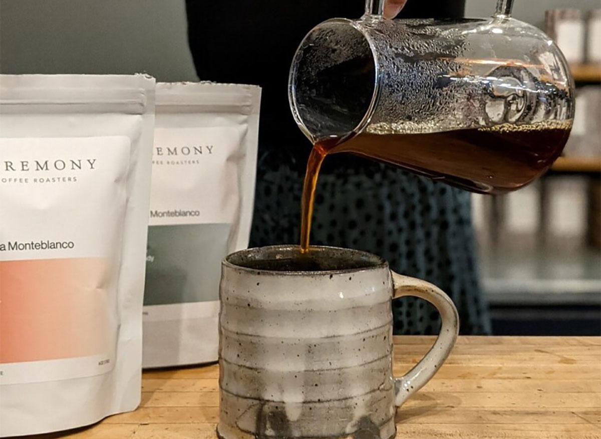 pouring coffee into a handmade mug