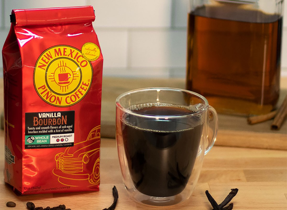 bag of coffee beans with clear mug of coffee