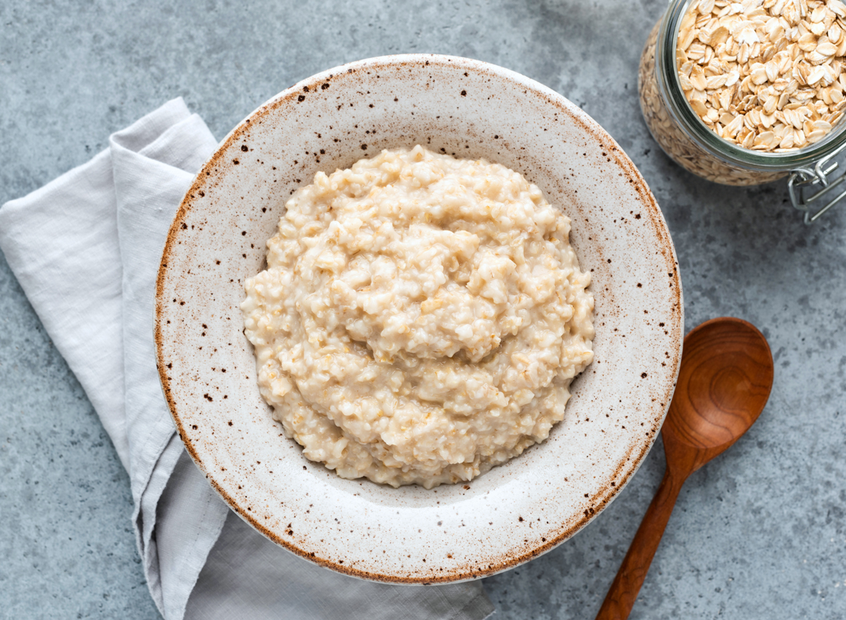 Plain bowl of oatmeal and raw oats