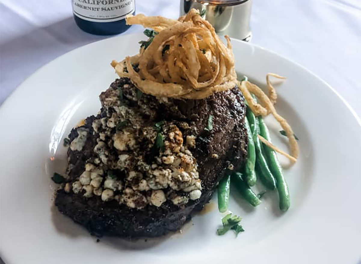 prime rib topped with bleu cheese crumbles and served with green beans