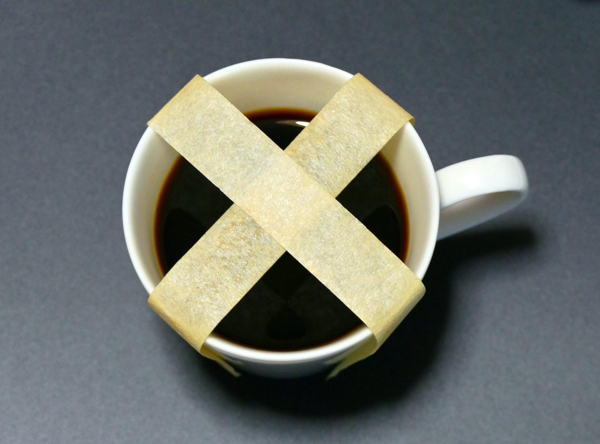 coffee mug with an x on it