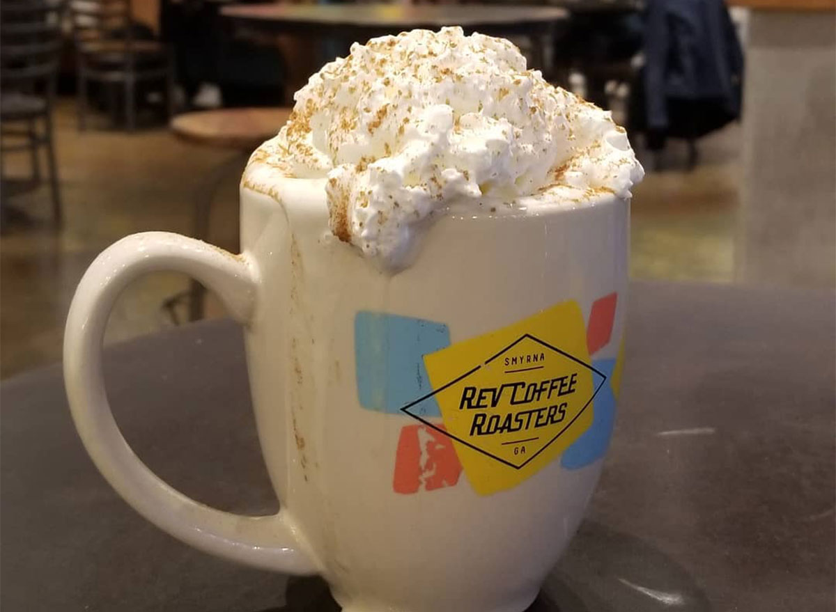 mug of coffee topped with whipped cream