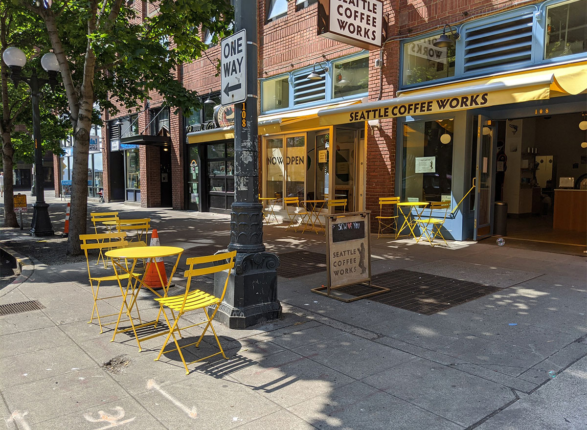 seattle coffee works exterior with outdoor seating