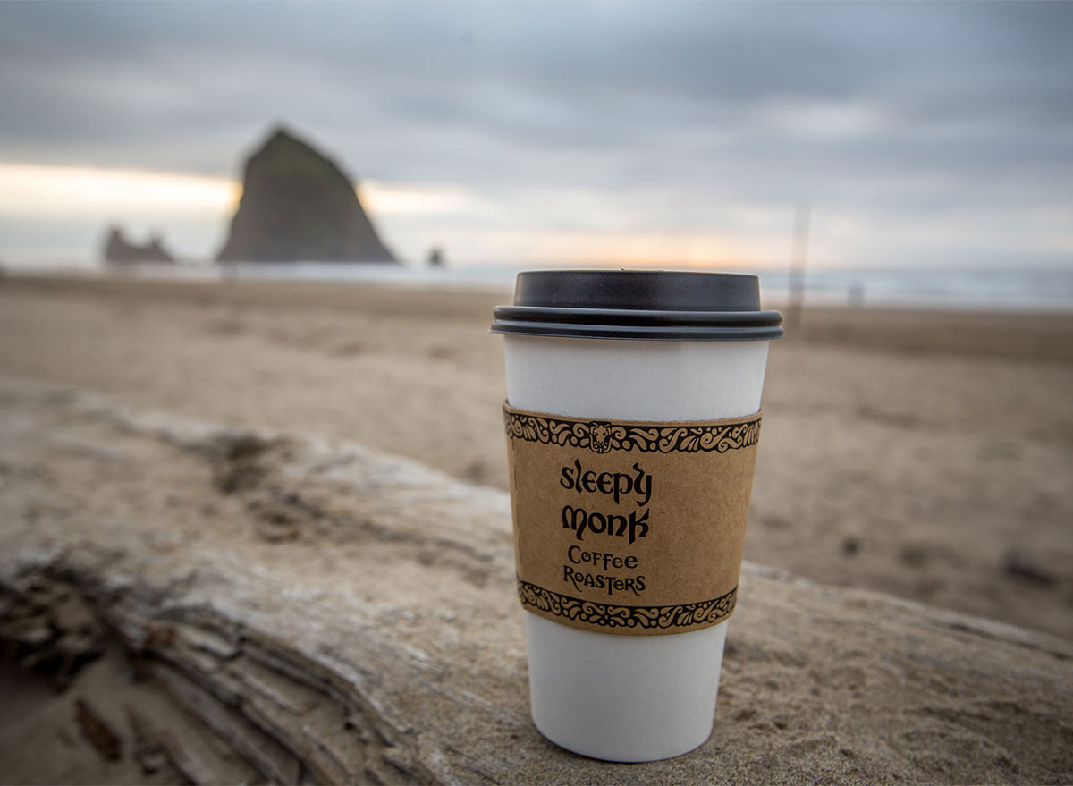 to go coffee cup on the beach