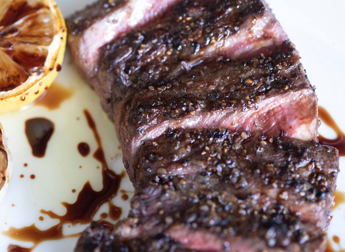 sliced steak with peppercorns