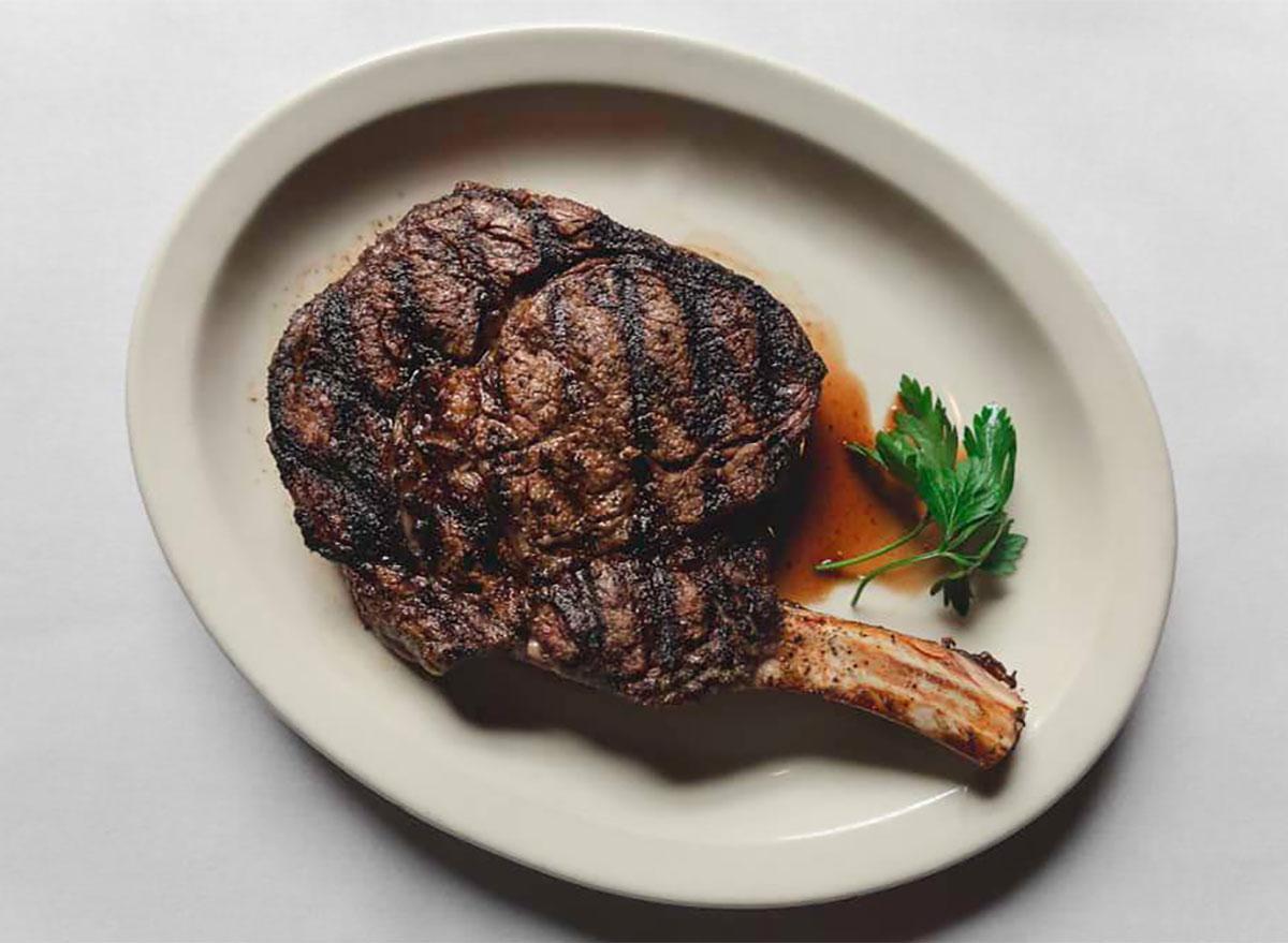 plated tomahawk steak with garnish