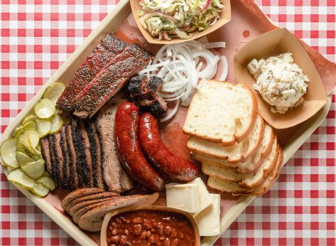tray of texas barbecue with bread brisket hot links