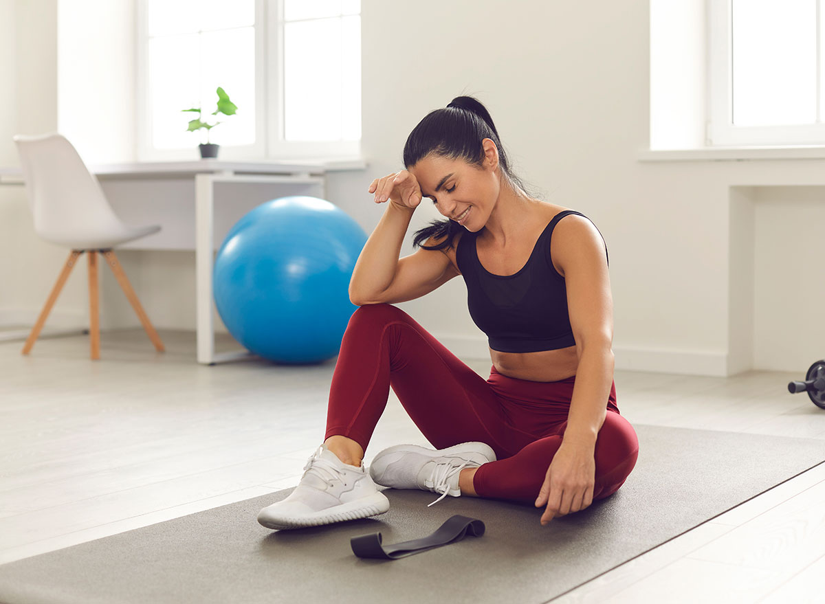 tired woman giving up exercising