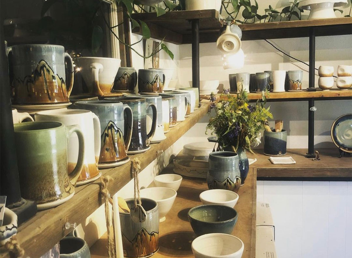 shelves of mugs and pottery