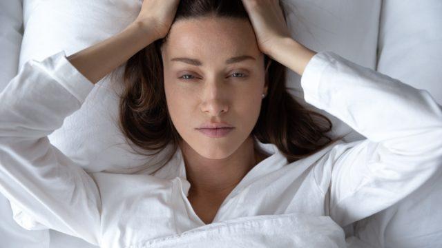 Woman covid migraine