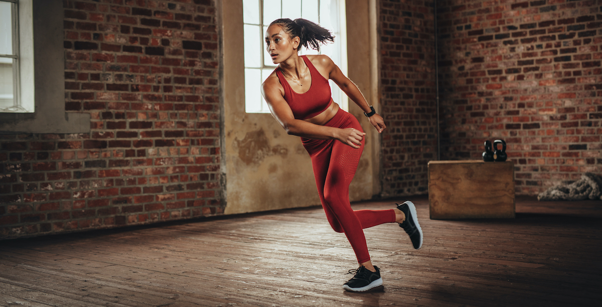 woman doing lateral jumps inside