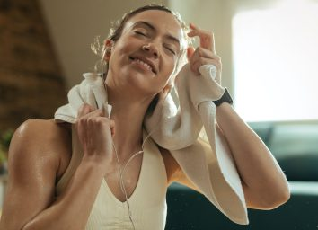 woman happy and sweaty after workout