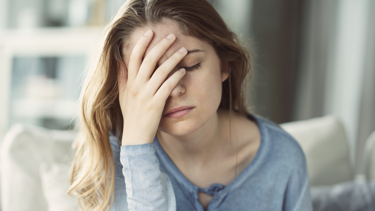 Young woman with headache