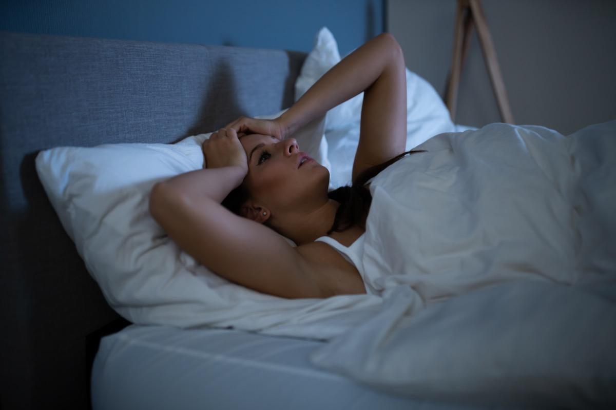 Sad Woman Lying On Bed