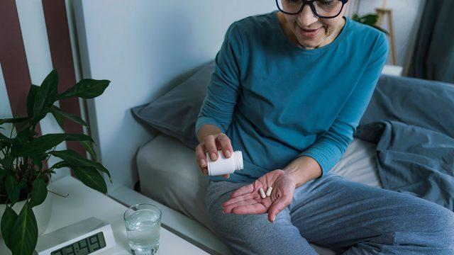 woman taking melatonin