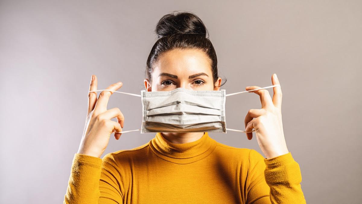 Woman wearing an anti virus protection mask.