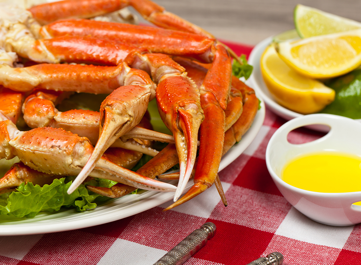 crab legs on plate with lemon and butter