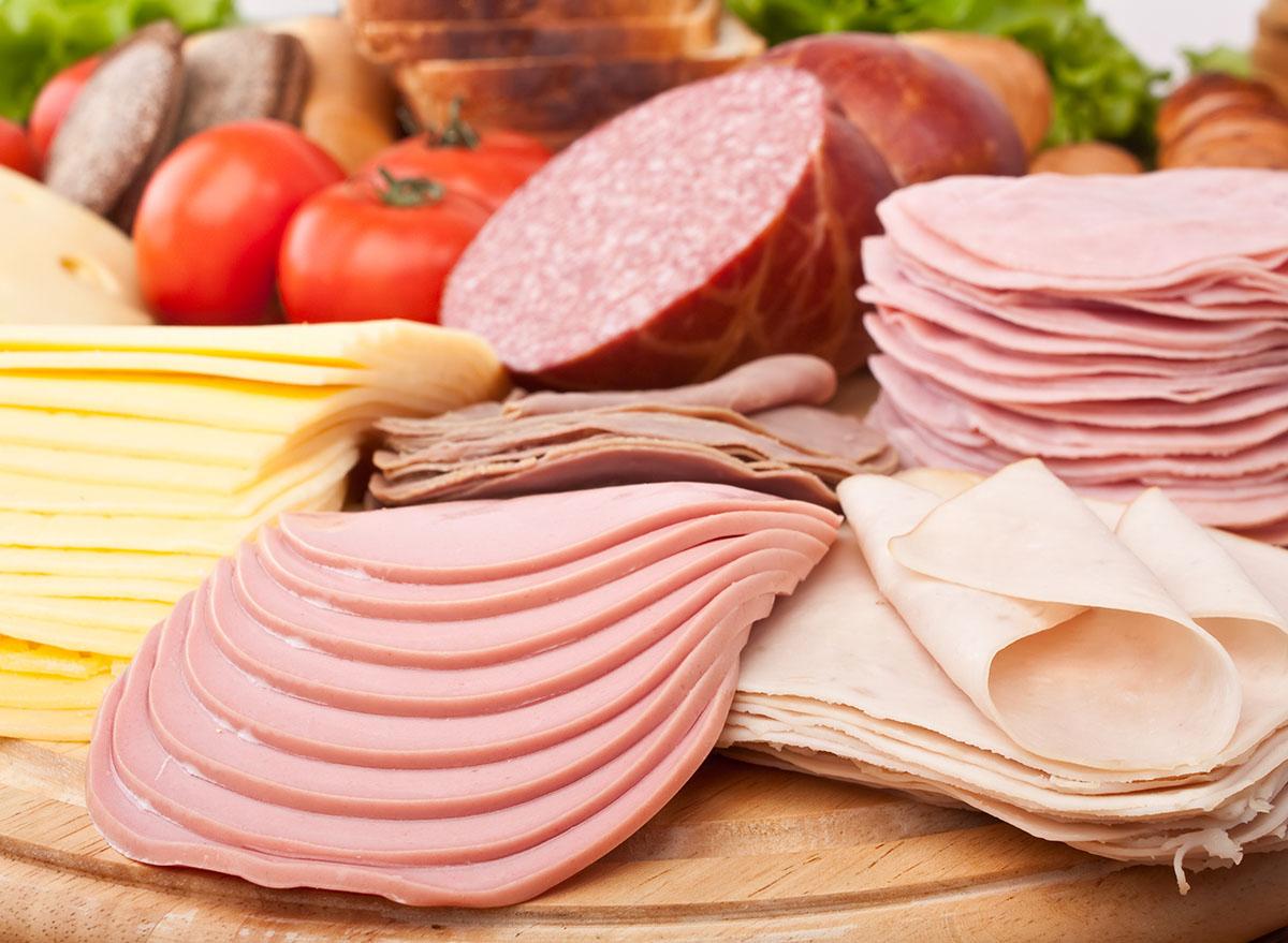 deli meats on wood plate