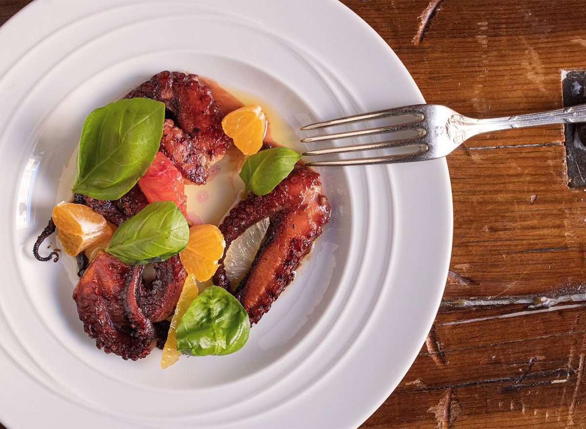 grilled octopus with citrus pieces