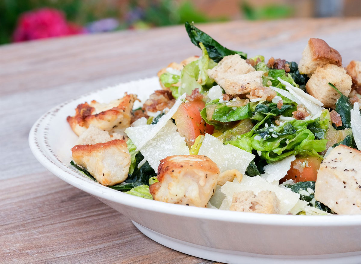 plated kale caesar salad with chicken