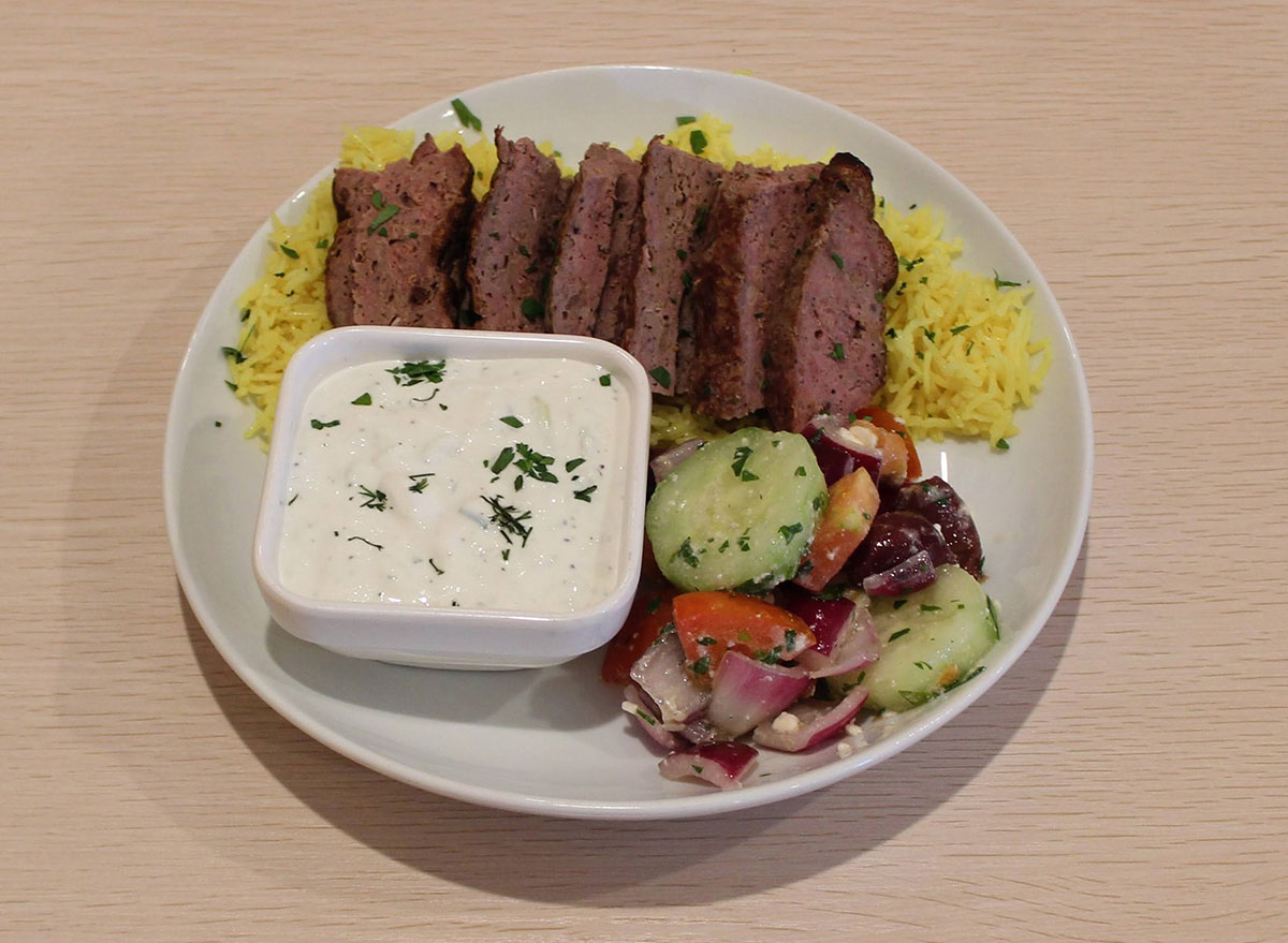 kebab platter with lamb greek salad and yogurt sauce