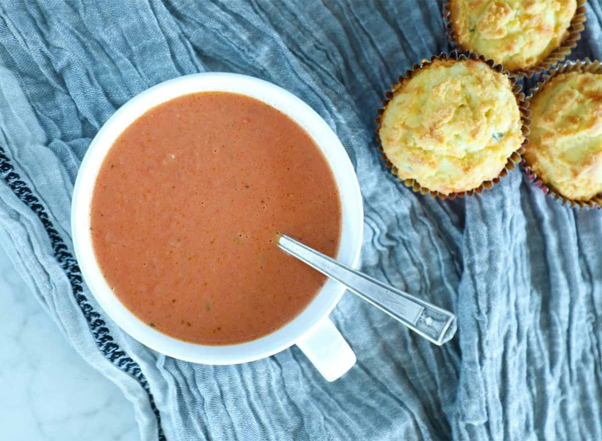 bowl of tomato soup with biscuits