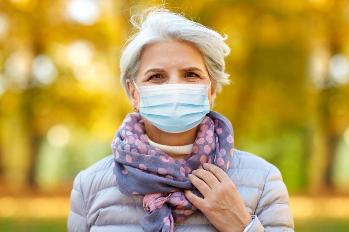 Senior woman in protective medical mask at park