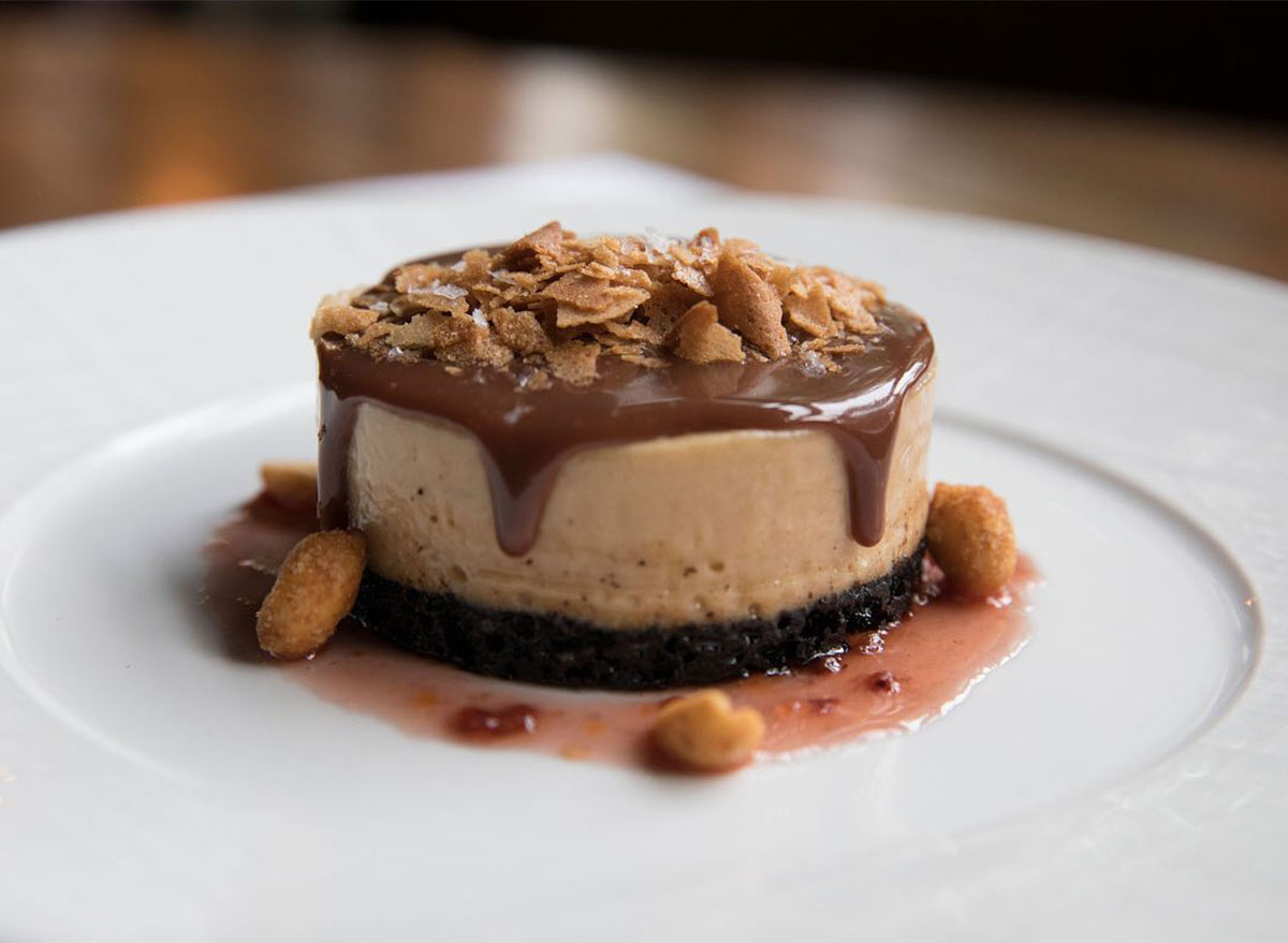 mini cheesecake topped with chopped nuts
