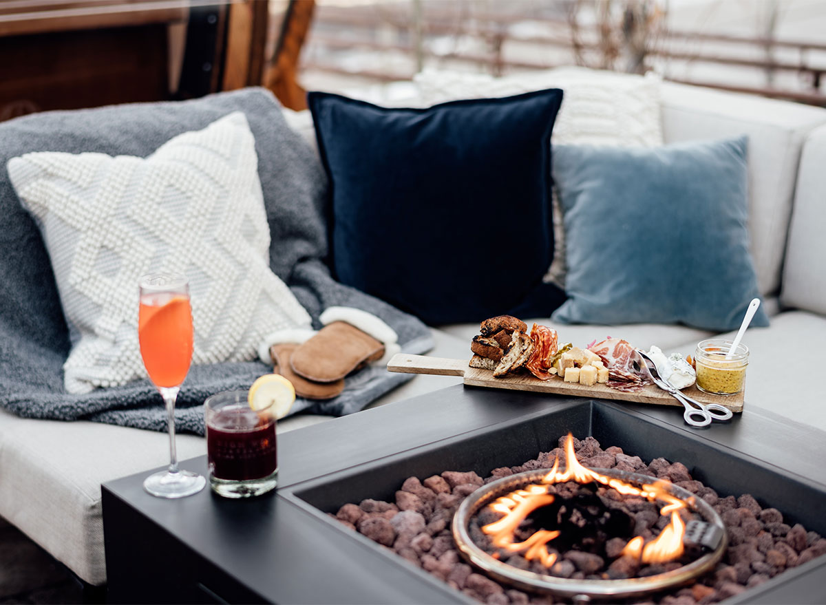 couch and pillows with fireplace
