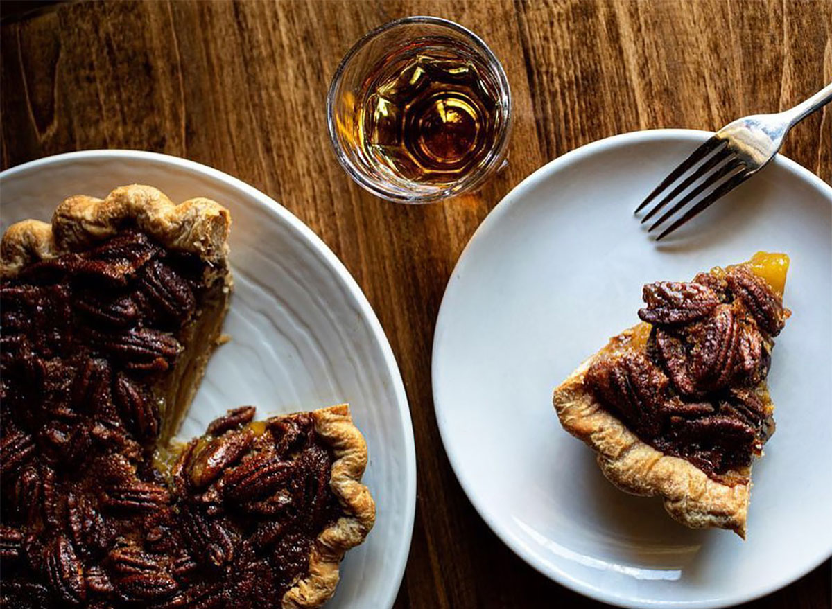whole pecan pie with slice