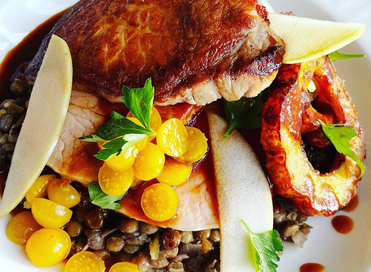 roast pork loin with yellow tomatoes and farro