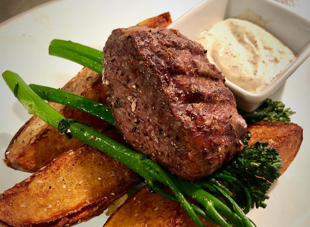 steak with broccolini and fries