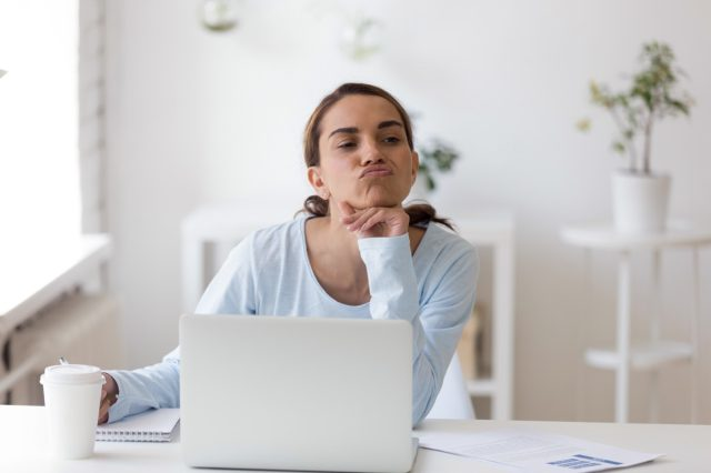 Employee tired to work taking a break making funny face