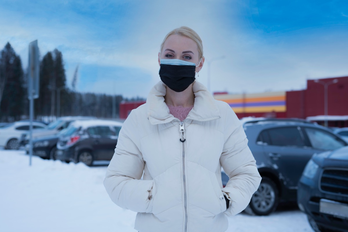 woman wearing two medical masks at the same time.
