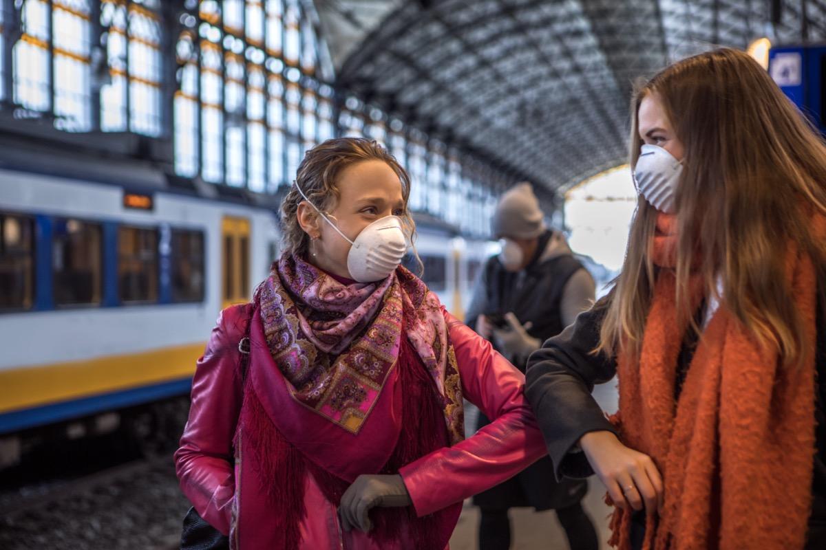 Friends meeting in public during virus outbreak
