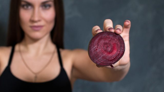 woman holding beet exercise workout performance