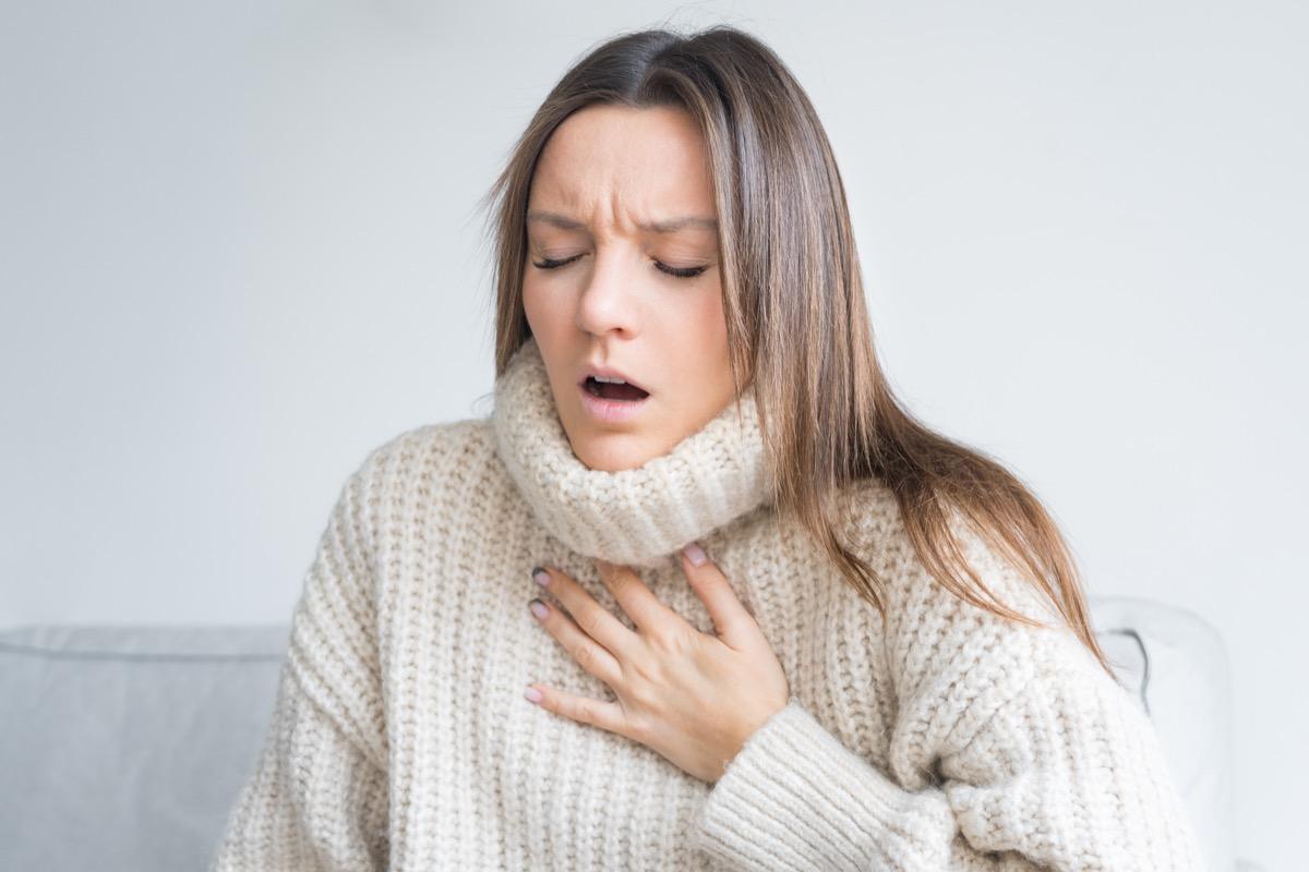 Woman having breath difficulties.
