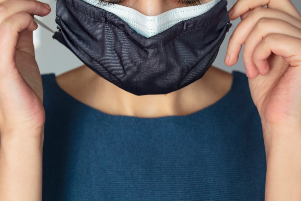 Woman wearing two protective face masks at the same time.