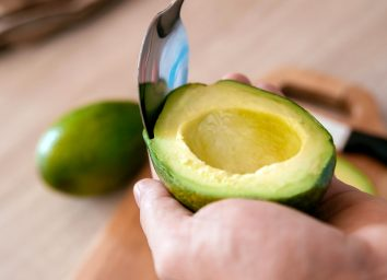 scoop avocado out of peel cut