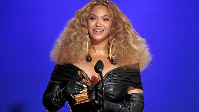 beyonce in black leather dress at 2021 grammys