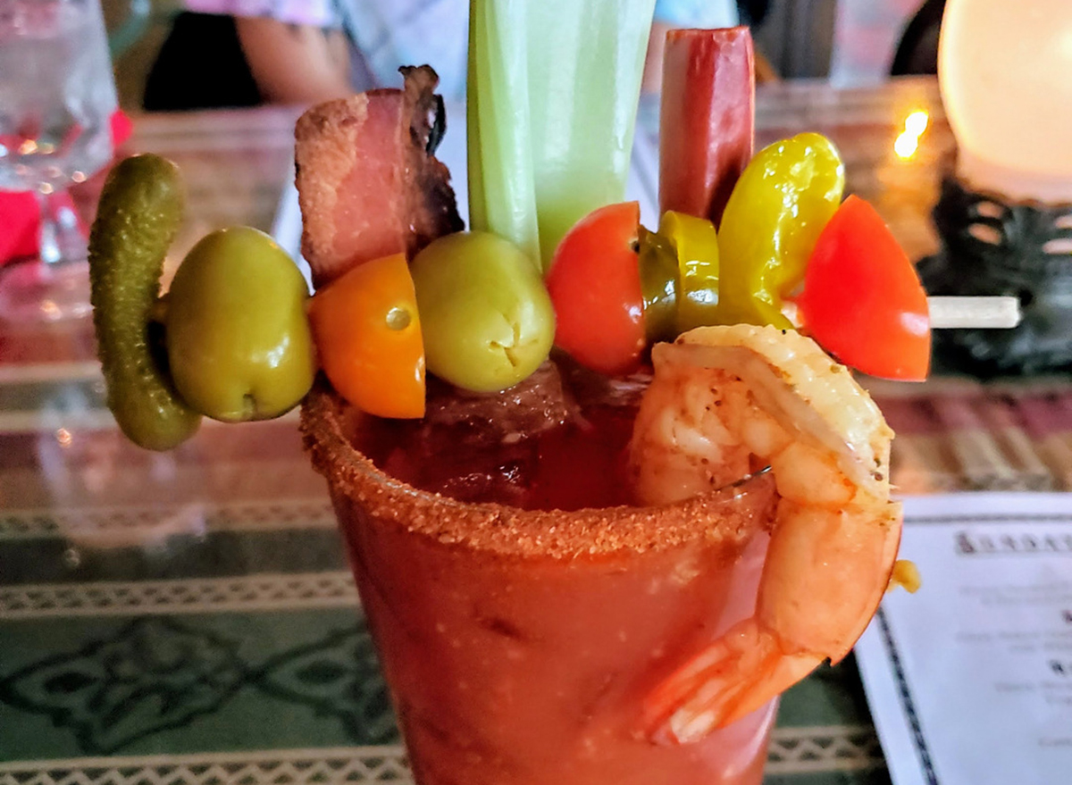 bloody mary topped with celery and tomatoes