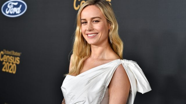 brie larson in white one-shoulder dress on red carpet