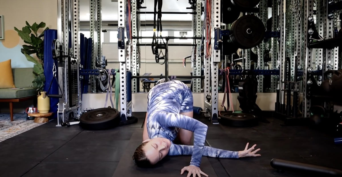 brie larson stretching one arm under her torso