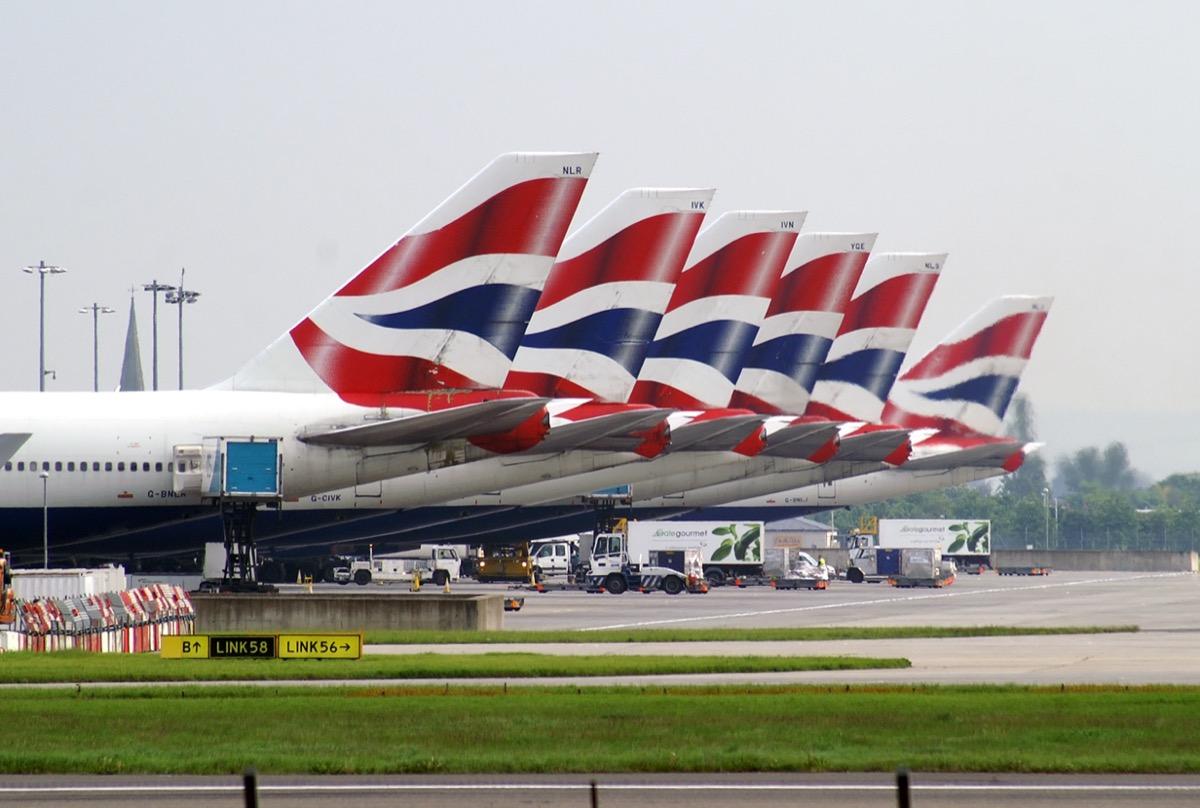 Fleet of Boeings 747 of British Airways standing on the apron of London Heathrow airport.