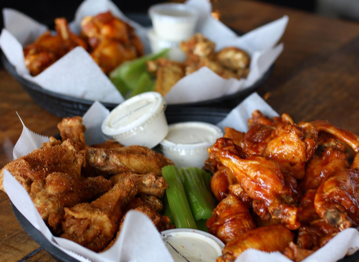 platters of chicken wings with ranch and celery